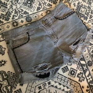 Grey distressed Free People shorts size 27